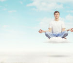 36293943 - young smiling guy sitting on cloud and meditating